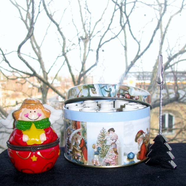 Christmas themed tin, a angel container and tree papaer clip