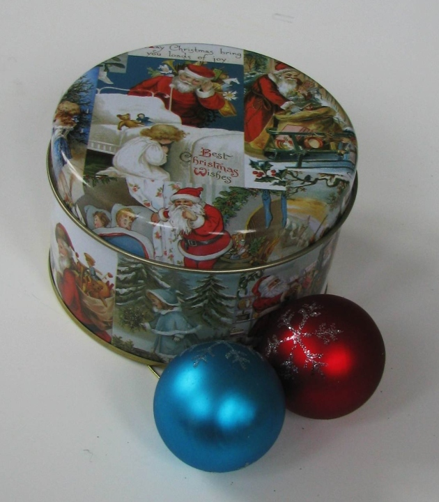 a Christmas themed cookie tin