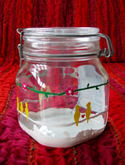 birds on a wire in a painted glass jar